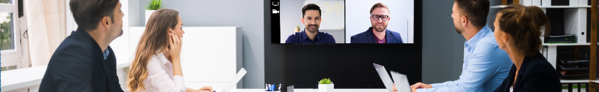 office meeting_staff_remote_inperson_hybrid workplace